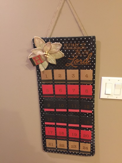 Recycled cardboard, a broken ornament, gift tags, and washi tape. A $6 Advent calendar!
